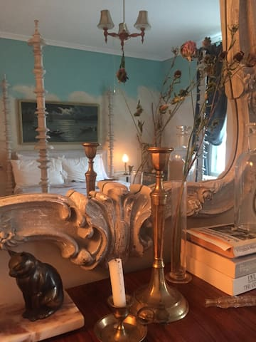 I love collecting antiques and vintage treasures, and the Cloud Room is full of both. Art deco lights blend with Victorian  mirrored cabinets and rustic flea market finds.