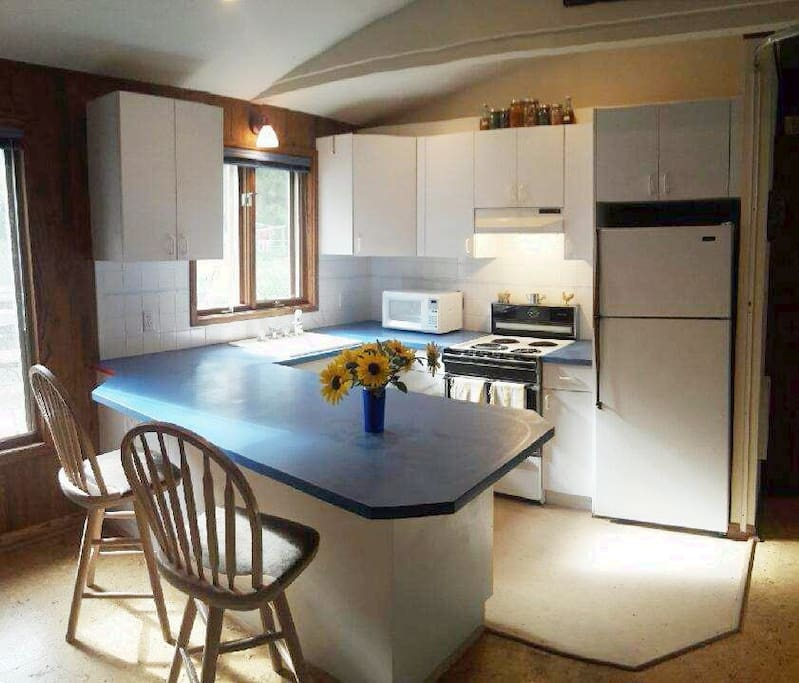 Our open kitchen includes all appliances and equipment you would need to cook at home.