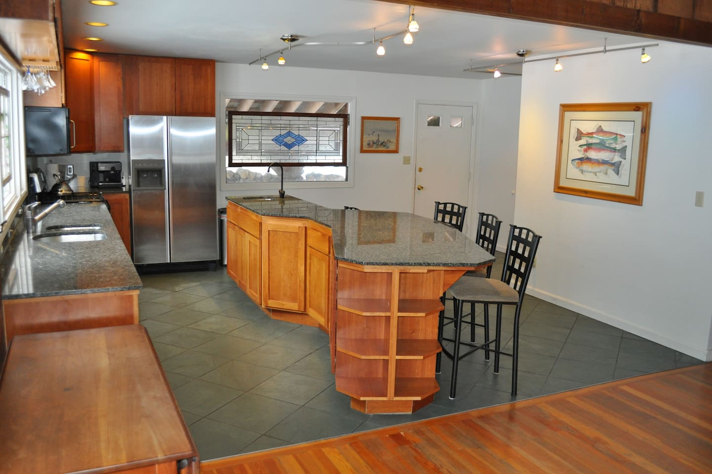 Gourmet kitchen with island seating for 8.
