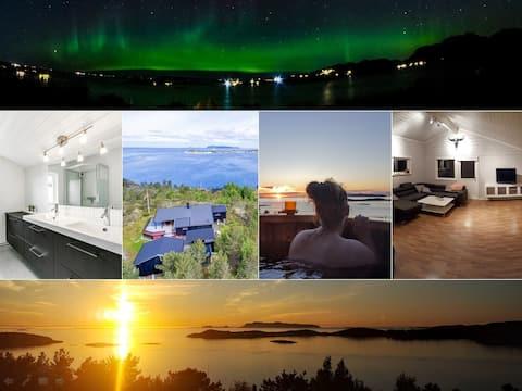 Panorama view, hot tub, modern 4 bedroom cabin.