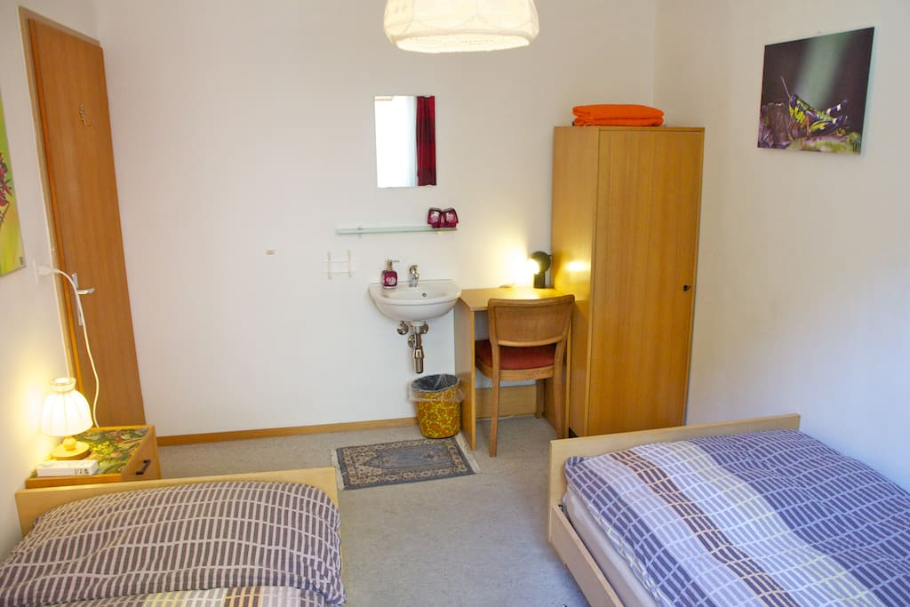 2 single bed room with wash basin.