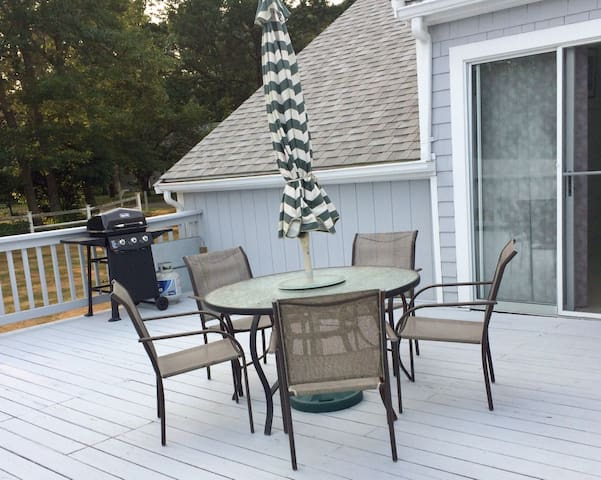 Outside deck with table and BBQ grill