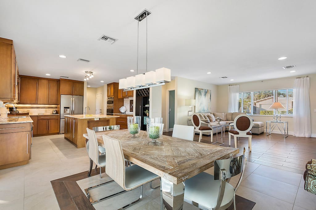 The open living room, dining area, and kitchen offers a great flow for entertaining.