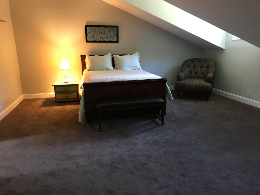 Loft-style bedroom w/queen bed,seating and fridge