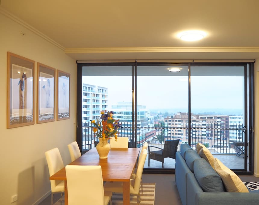 Separated by alfresco sliding doors, the living room flows invitingly through to the balcony.