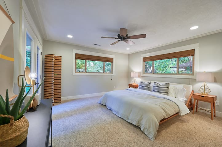 The master bedroom features a king-sized organic mattress and luxury bedding.