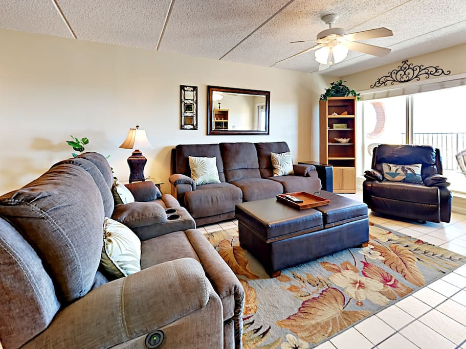 Unwind in the living room. The sofa, loveseat, and chair all recline.