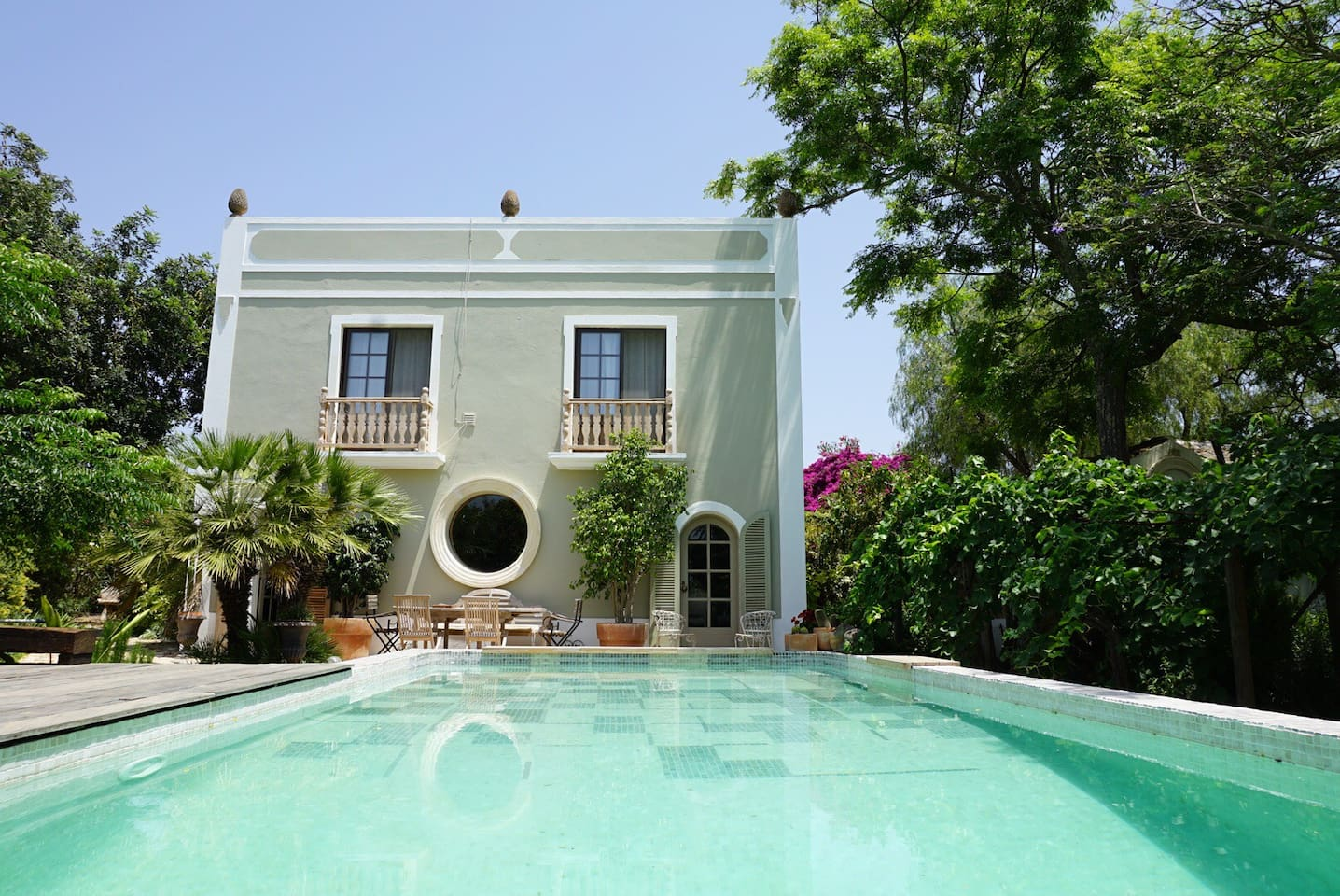 our great swimming pool- you are welcome to use it :)/ our main house in the background, the cottages are to the right /