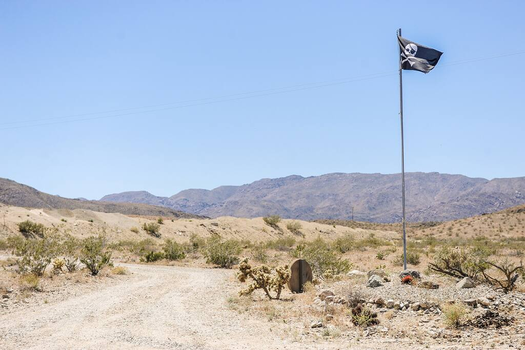Jolly Roger welcoming committee. View South of the entry/driveway. Joshua Tree National Park, just behind the hills.