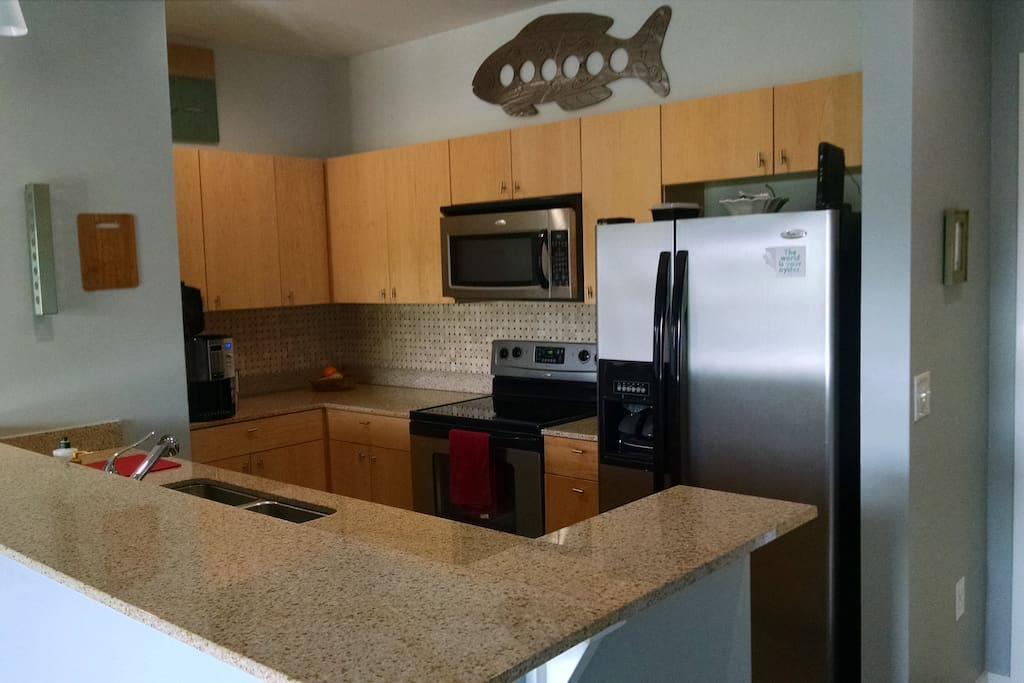 Fully equipped kitchen off of living room