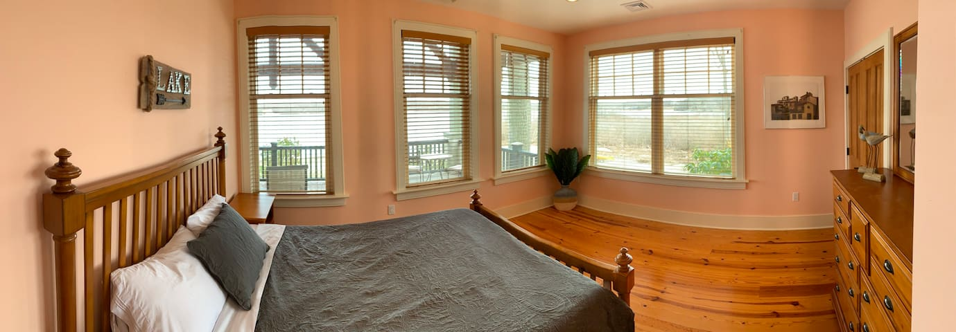 This guest room has 1 queen bed and 4 windows facing the water. Love early morning sunrises, choose this room.