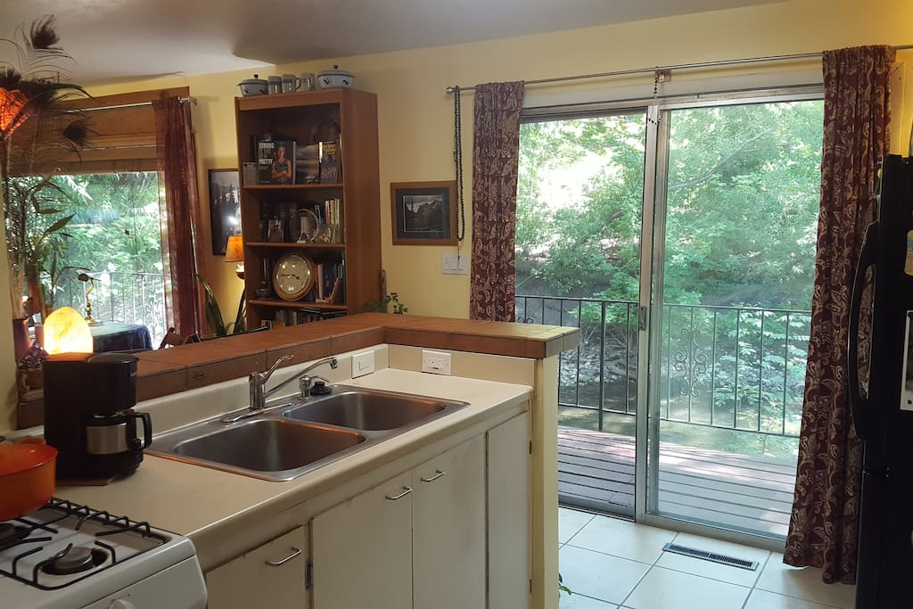 Kitchen, gas range, coffee maker.