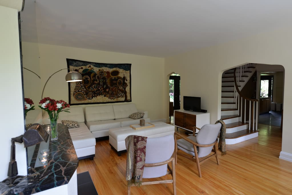 Large, beautiful living room - with passageway to the dining room in the back corner, and to the front foyer