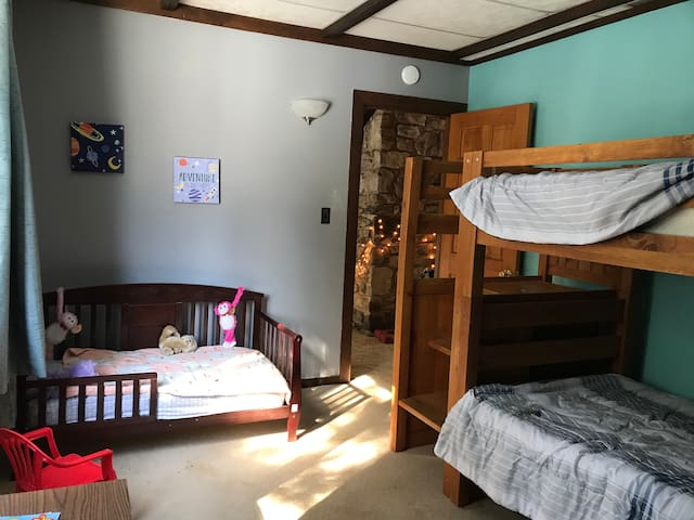 There's a children's room upstairs with a bunk bed and toddler bed.