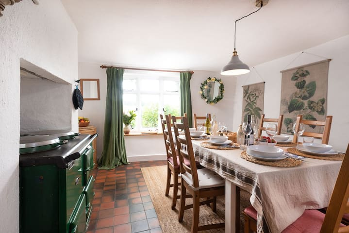 Spacious dining room with countryside and garden views