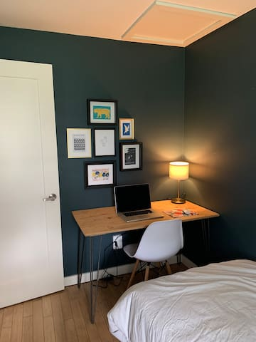 Small bedroom with workspace