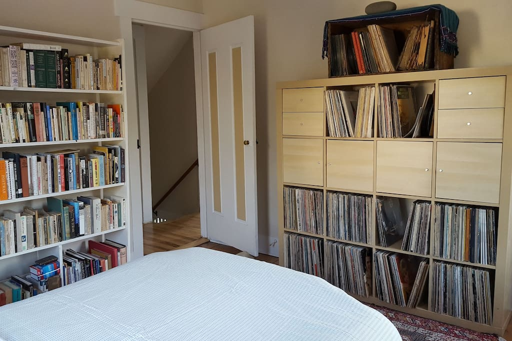 Surrounded by books and record albums.