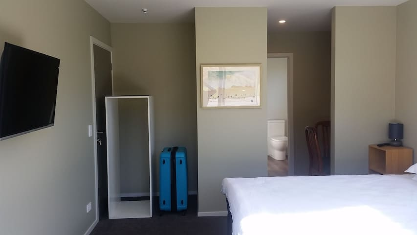 super king sized bed, TV and storage space