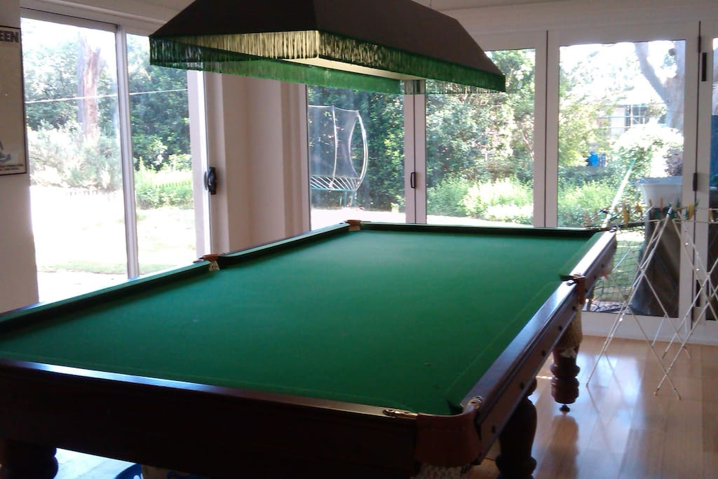 Big rumpus room (with adjoining toilet) opening onto large garden through bifolds. Separate access to this area via a gate. Esky plus tea and coffee facilities here, also electric frypan if needed, utensils, disposable plates, gas heater for cold weather, use of dartboard and pool table, plus use of indoor table and chairs if desired.