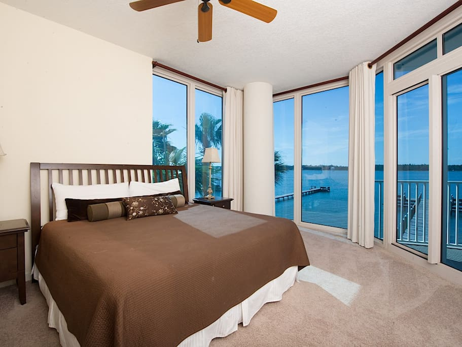 The master bedroom with king-size bed and water views