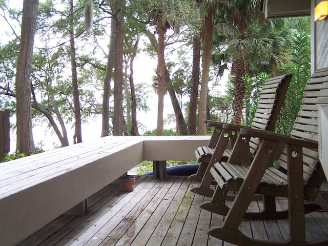 Rockers on the back porch over looking the water 30 feet away.  Bench seating for friends.