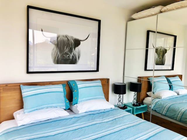 """Master Bedroom with King size bed, 32"""" wall mounted smart TV, aircon and ceiling fan"""