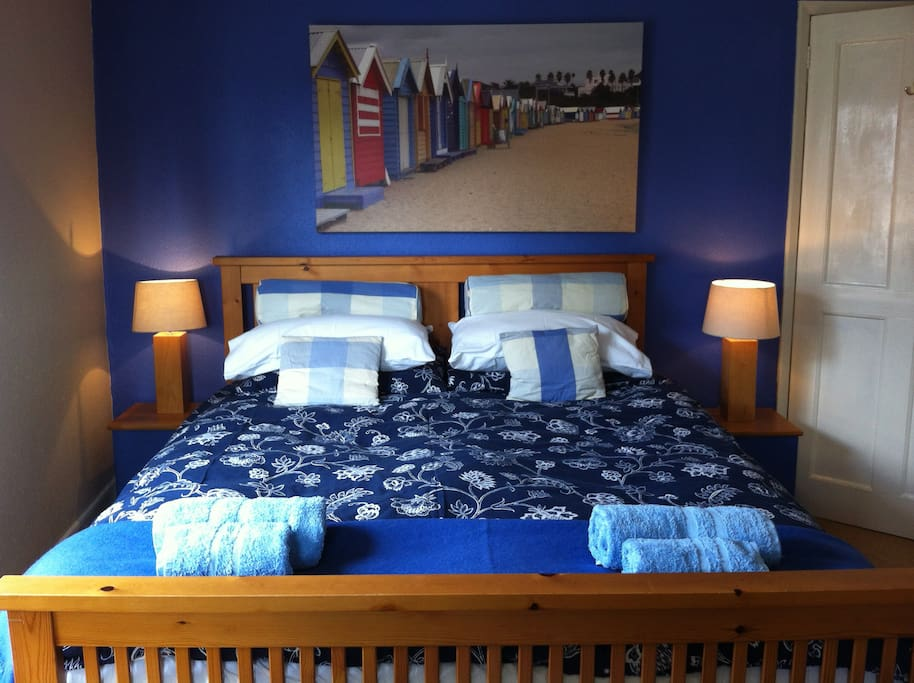 King sized bed in master bedroom with 2 windows, facing W and NW. Our beds are extremely comfortable and good quality.