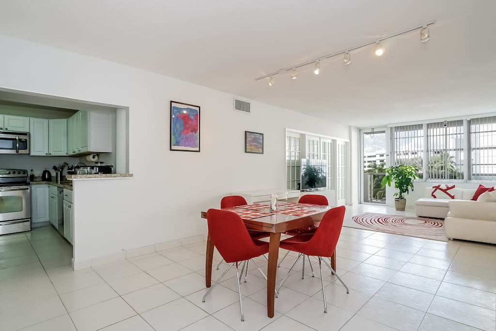 Spacious living room with seating area and dining (table unfolds to fit 8-10)