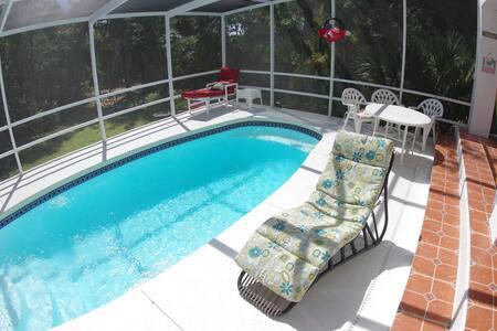 Gulf Getaway, pool, hot tub, kayaking to beach.