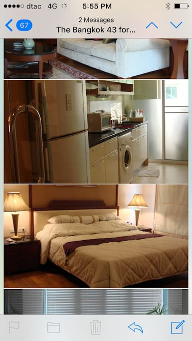 Top : A kitchen furnished with a refrigerator, a range, and a clothes washer.  Bottom : A king size bed in the spacious master bedroom.