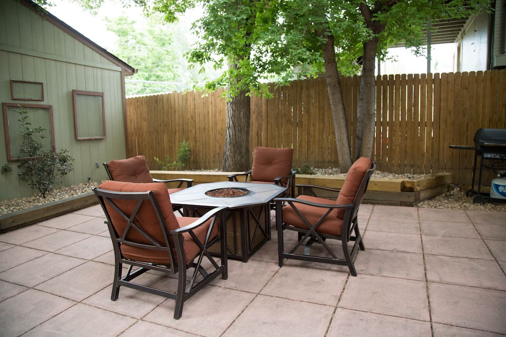 Backyard patio with gas fire pit and gas grill
