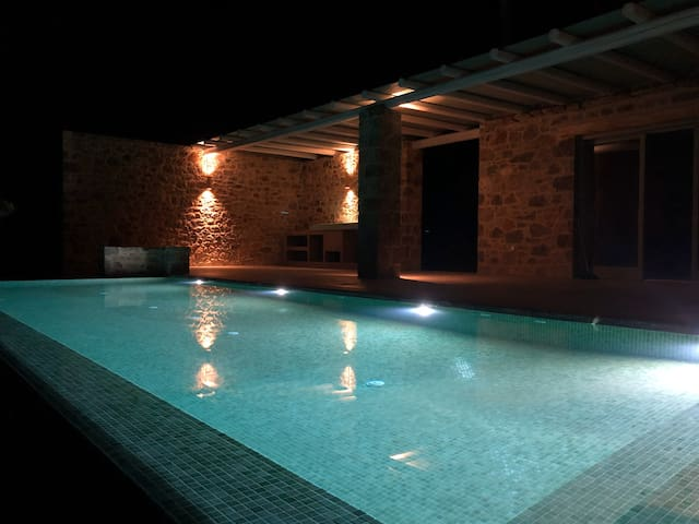 Private swimming pool at night