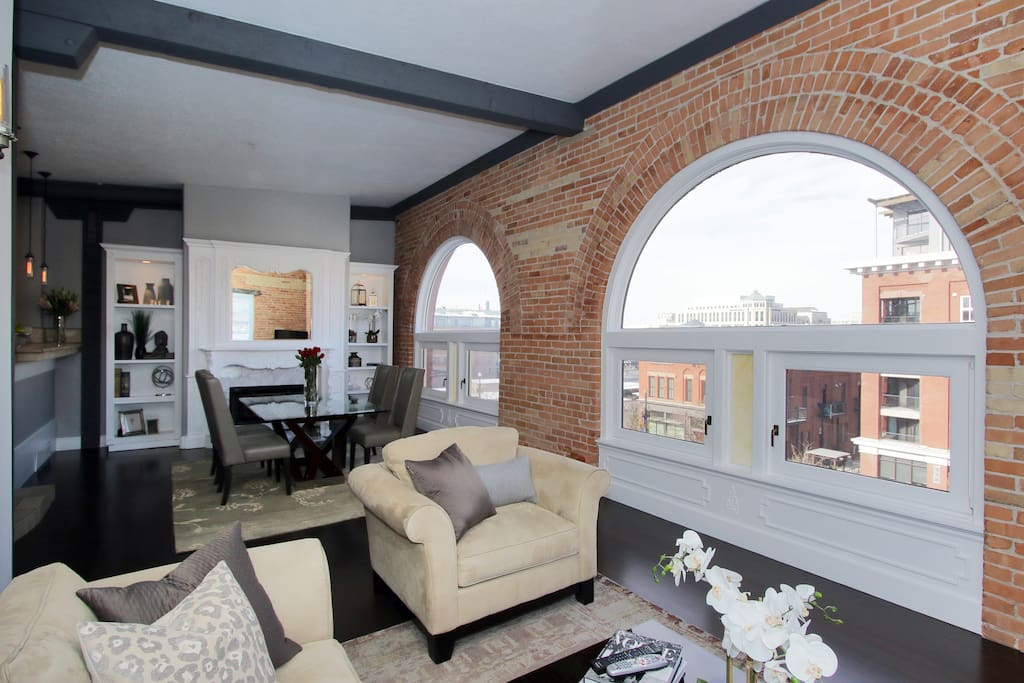 Living/Dining room with 2 large Arched windows and city and mountain views