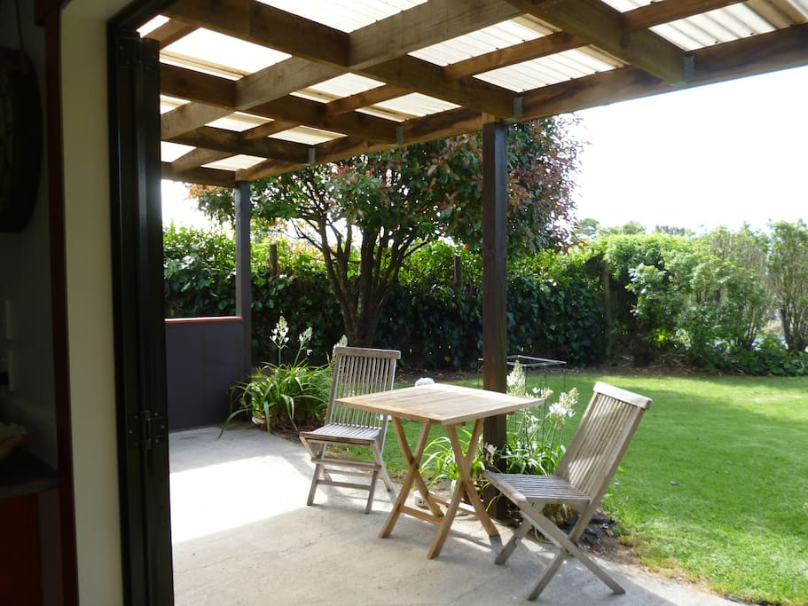 Pleasant outdoor covered patio garden space to watch the sunsets.