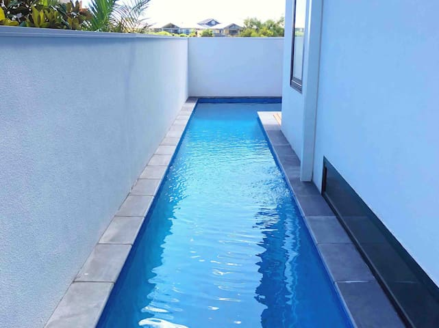 12.5m long heated lap pool — it joins at the northern end of the property into the 7.5m x 3m main/entertainment pool