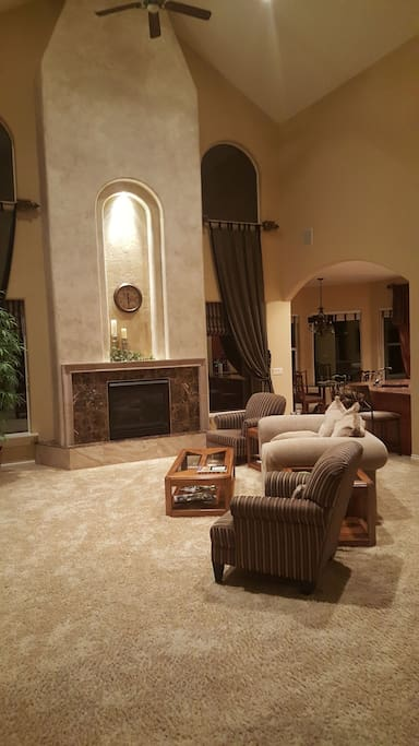 living room with gas fireplace 28 foot cathedral ceilings