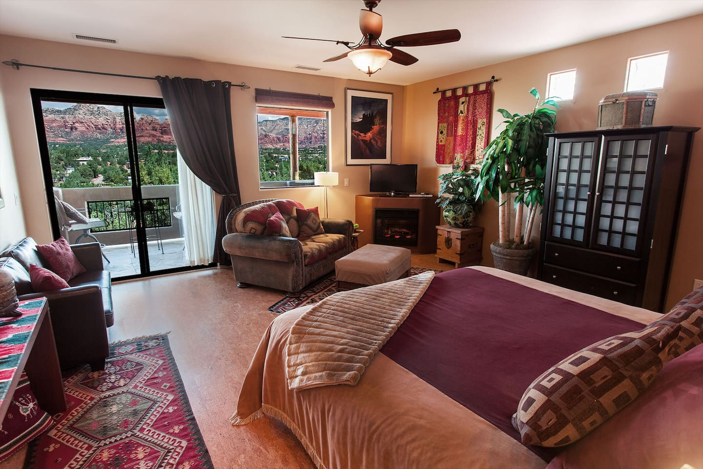 The living/bedroom has a king bed, panoramic red rock views throughout, electric fireplace, HDTV, iPod dock, armoire, traditional southwest cloth/leather loveseat and full kitchen.