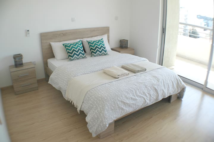 Master bedroom has queen size bed with fresh linen and towels