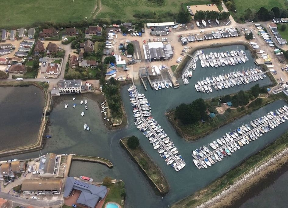 Aerial view of yurt site and yacht harbour.