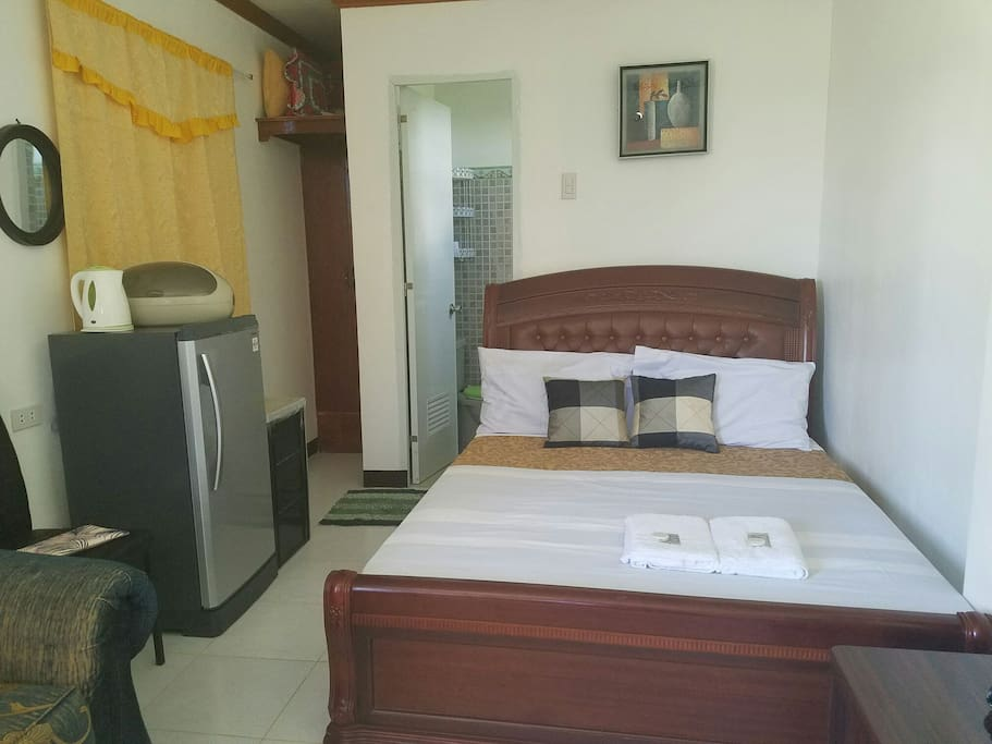 queen size bed with private CR (hot and cold shower)