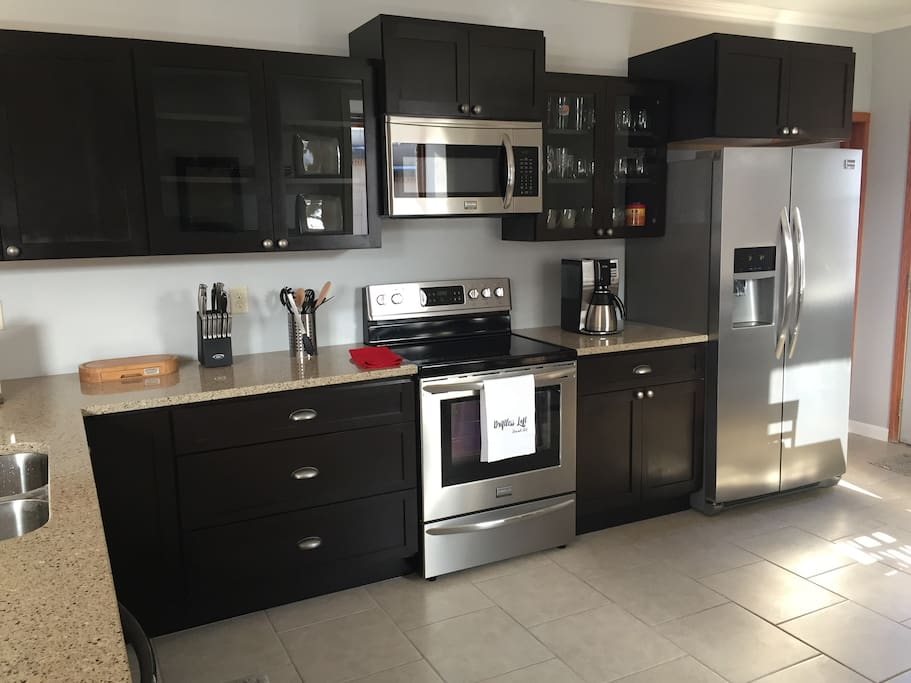 Kitchen equipped with brand new stainless steel appliances