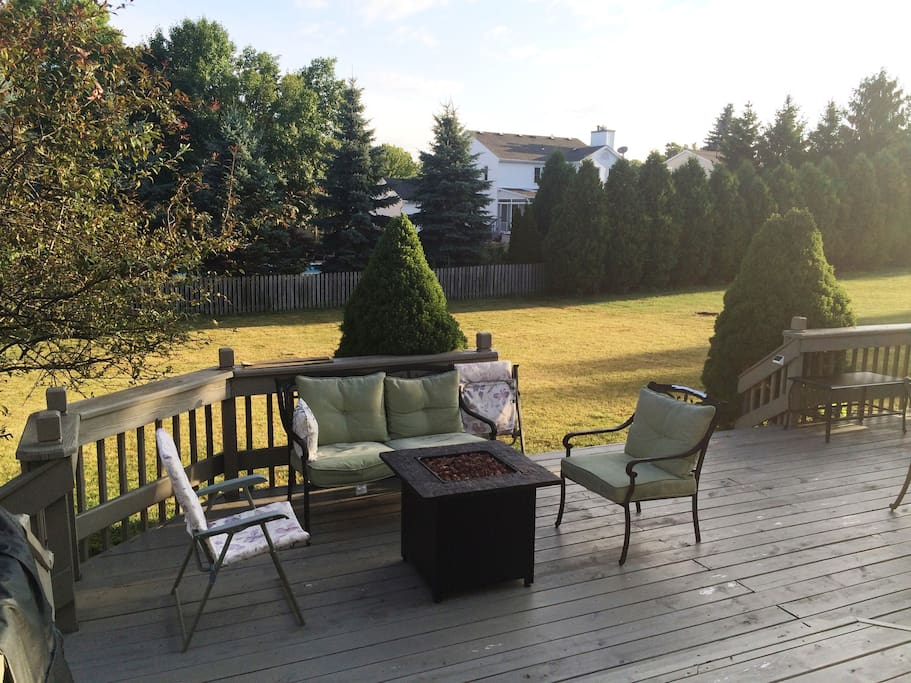 Large, 2-tier deck features grill, table and 4 chairs for eating, as well as separate seating area with gas burning fireplace.