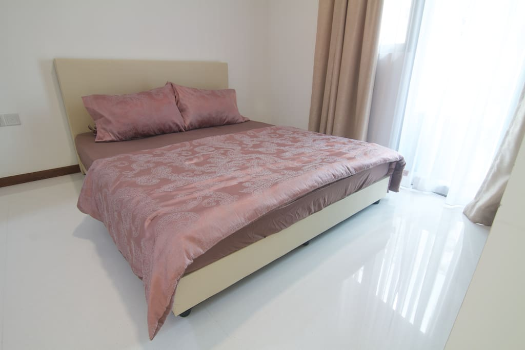 Queen-sized bed suitable for 2 people