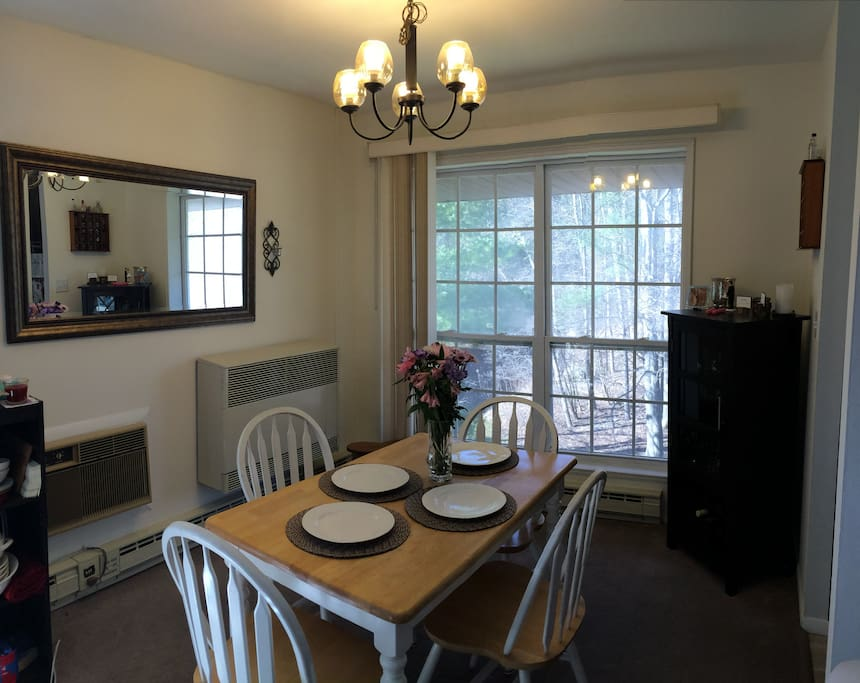 Dining room.  Dining room table that comfortably seats four.  Wine cabinet, chandelier, and warm decor.  (card table and folding chairs available for additional seating.)