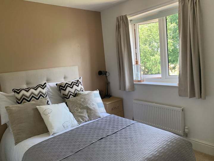 Bright double room with private bathroom.
