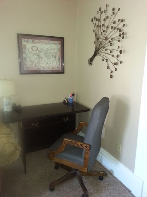 Comfortable desk and rolling desk chair.