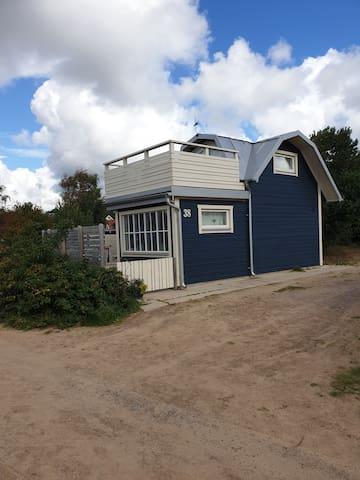 Stuga med havsutsikt i Halmstad