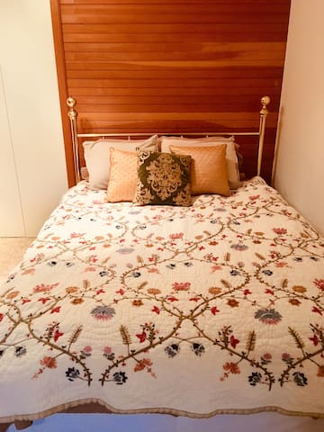 Brass bed with new mattress  + down comforter + pillow selection (sooffttt >>>Tempurpedic)  to ensure a  great nights sleep.
