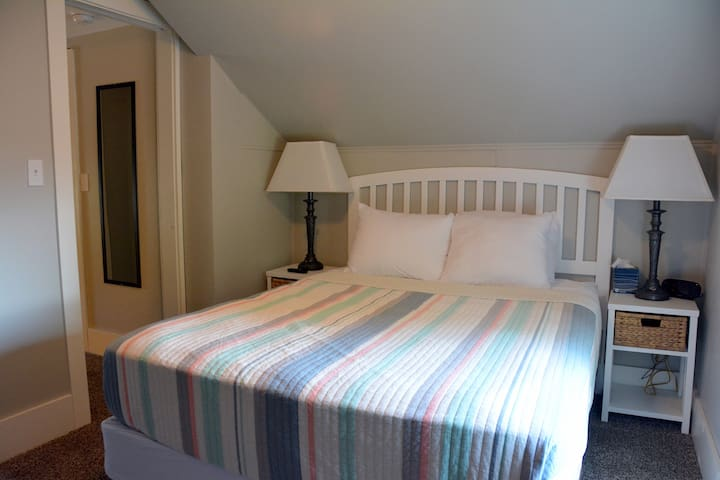 The Set Room upstairs in the FlyBridge Suite has a comfy queen bed and comfy needed amenities.