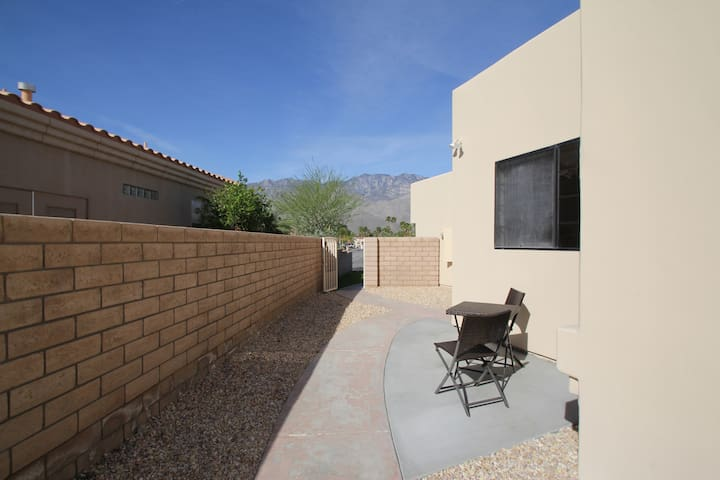 front patio with secure gate to entire privately enclosed casita area